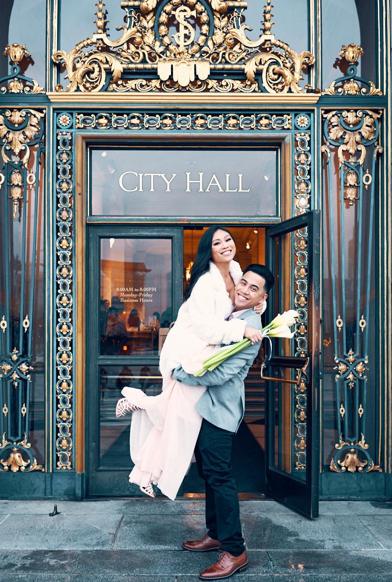 wedding-portrait-photographer-outside-city-hall-sign-afewgoodclicks