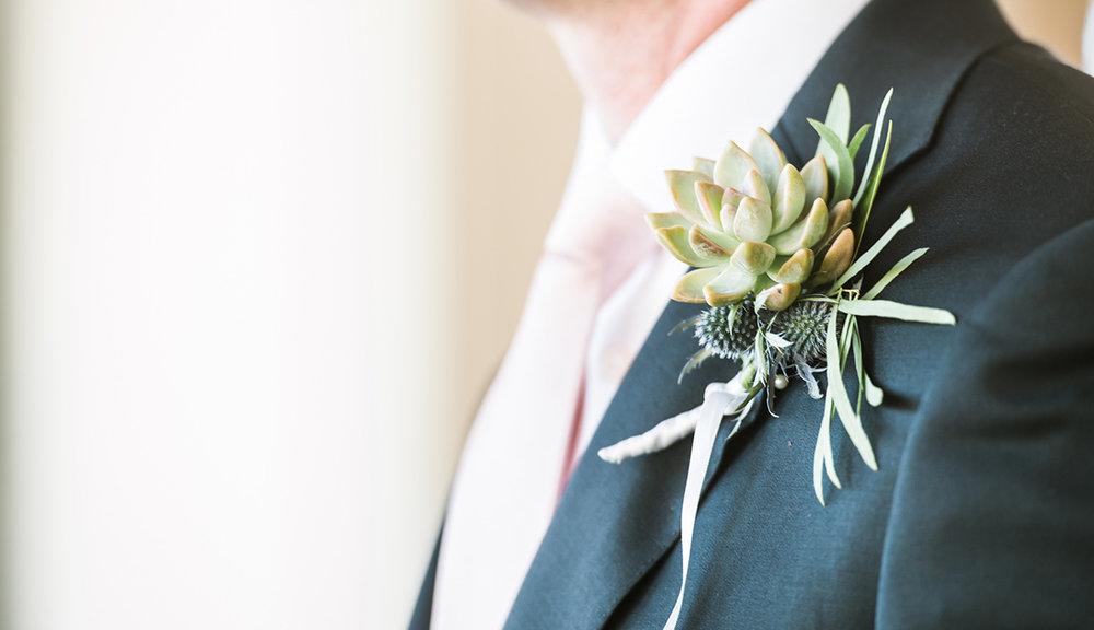 grooms-jacket-flower-succulent-photography-sandhill-hotel
