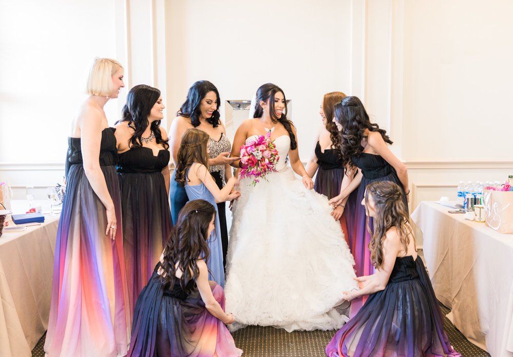 bridesmaid-helping-the-bride-get-ready-at-ruby-hill-ca