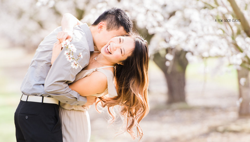 smiling-couples-poses-at-almond-blosson-bayarea-ca