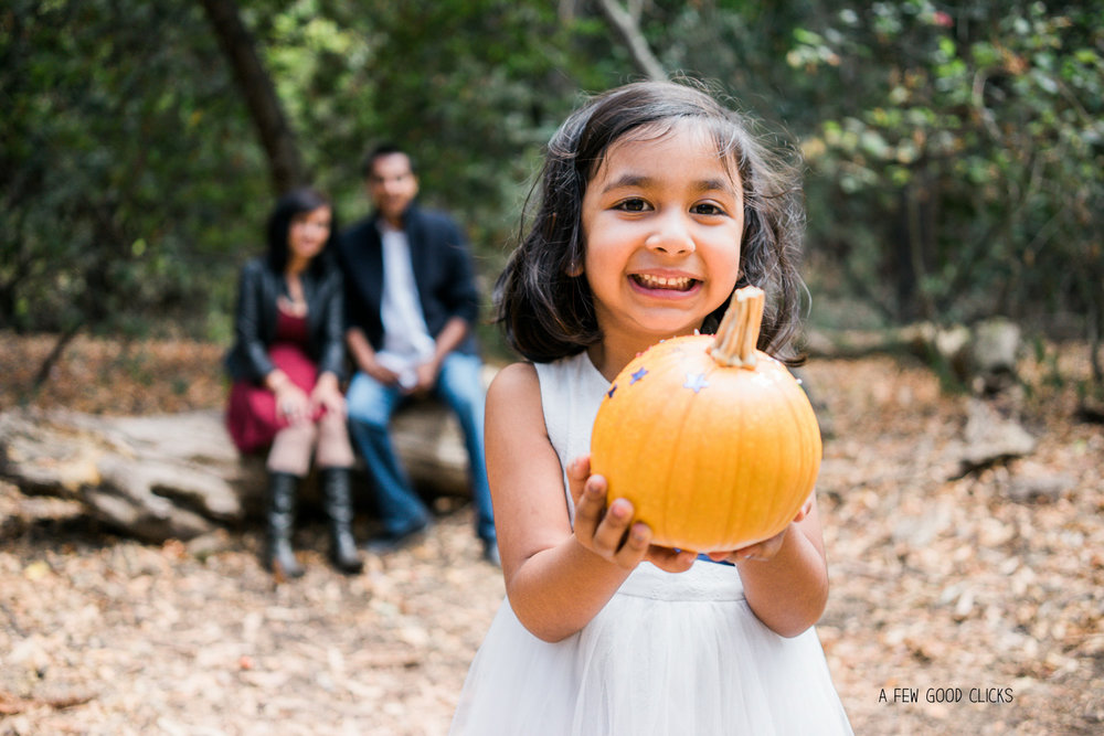 fall-family-photoshoot-pumpkin-prop-with-child-san-carlos